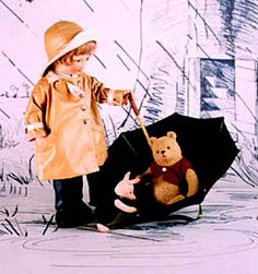 """RJW Dolls presents - Christopher Robin Series II. 18"""", molded felt, fully jointed, raincoat, rubber boots, umbrella. Date of Release: 1986-87. Ltd. Ed. 500."""