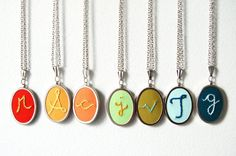 Embroidered initial necklaces from etsy seller merriweathercouncil.  Now, what color combination should I go for?