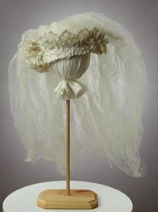 oval-shaped, white satin decorated w/ crowning of lace studded w/ pearls & clear crystal bead work. Organdy flowers decorate right & left of head piece. Full double layer short tulle veil is tightly gathered into center top of head piece. Vintage Wedding Hair, Vintage Bridal, Vintage Weddings, Crown Centerpiece, Wedding Centerpieces, Wedding Veils, Wedding Dress, Wedding Hair Accessories, Bridal Headpieces