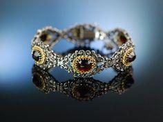 Graz um 1980! Trachten Armband zum Dirndl,  Silber 835 vergoldet große Granate, Kordel Dekor, garnet silver bracelet, traditioneller Trachtenschmuck bei Die Halsbandaffaire