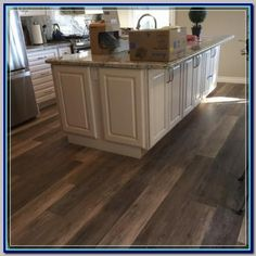 (paid link) Pros: Hardwood kitchen flooring makes for a more everlasting other than kitchen floor tiles and is much easier to repair. Cons: Overtime, hardwood ... #woodfloorkitchen Vinal Plank Flooring, Vinyl Flooring Kitchen, Wood Floor Kitchen, Luxury Vinyl Flooring, Luxury Vinyl Plank, Bedroom Flooring, Kitchen Vinyl, Pvc Flooring, Kitchen Redo