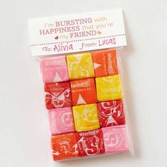 Starburst Candies Valentine Tag. Super cute idea! And easy too! Just cut the top off of a regular ol' plastic bag and fill. For the label, fold a piece of cardstock in half over the opening of the baggie and staple in place.