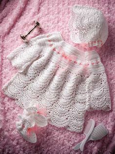 """Intricate and absolutley precious christening set.   Crochet this adorable set using 5 balls of Premier® Yarns Afternoon® Cotton yarn and a U.S size  F/5/3.75 hook. Pattern includes instructions for a gown, bonnet and booties in size 12 months, with chest measuring 21"""" and length 141/2""""."""