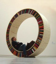 Now you can store your books, sit and relax, or take your bookshelf for a walk with this circular bookshelf.