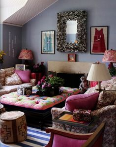 the 'full of furniture' look.  Print fabrics, great use of colors, and playing up the architectural features does a brilliant job of camouflaging that the space is too small for the number and scale of furniture