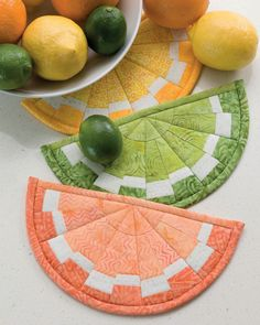 Add a splash of sunshine to your kitchen! These fruity hot pads are made with wedges cut from a simple strip set.