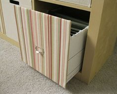 We are in dire need of storage in our office area. Adding inexpensive Expedit bookshelves might be the way to go...but we'll need file storage!  This is brilliant & economical.