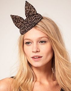 ASOS Cat Ears Fascinator Hat    Cat ear fascinator by ASOS Collection. Featuring a leopard print finish with a small, domed crown, and elasticated strap and raised cat ear detailing.