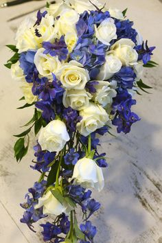 KellysFlowers_Cascade Bridal Bouquet of White Roses and Blue Hydrangea and Blue Delphinium.jpg