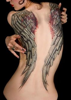 Awesome wings tattoo, love the blood.