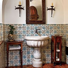 Thoughtful Reproduction: Thad went to great lengths to produce the kind of crafted details that confer a sense of authenticity. Hand-painted tiles and a marble basin are hallmarks of Mediterranean Revival style. The geometric tiles are from Ann Sacks.