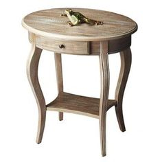 "Display fresh florals or flea market finds on this warmly weathered accent table, showcasing 1 drawer and cabriole legs.  Product: Accent table    Construction Material: Solid woods and wood products    Color: Driftwood   Features:  Wonderful addition to virtually any space    Will enhance any décor    Includes one drawer with antique brass finished hardware and a lower display shelf   Dimensions: 26"" H x 24"" W x 18"" D"