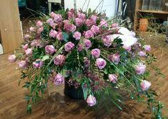 Rustic purple rose & wax flower casket spray (500) by Kutchey's Flowers Midland , Michigan