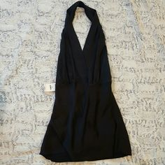 NWT Silk Black Express Halter Gorgeous top. Perfect for a hot summer night. Only worn once to model for photo. Surprising amount of support in bust. Tags price is $49.50 Express Tops Blouses