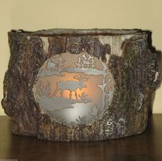 Canadiana Style Heavy Resin Tree Trunk Stump Moose Candle Holder. Very nicely done. $49.95 on eBay with FREE U.S. & Canadian shipping.