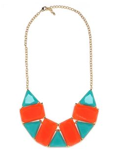 This stunning statement necklace is perfect for those bound for St. Tropez—or those who just want to look like they are. It features oversized faceted gemstones, in bright azure and crimson, that come chicly arranged in a fun mosaic pattern.