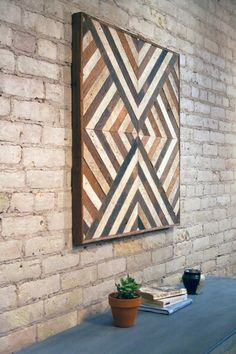 This is a one of a kind wall piece that is made from old lath wood. The frame is made from the same material. It can be hung from any side you choose. This could also be used as a side table or nightstand if you add legs. It is made from reclaimed lath wood that was originally