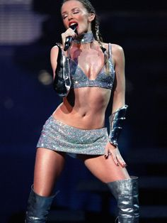 Kylie Minogue silver dress | Pop Singer Kylie Minogue Performing Wearing a Silver Mini Skirt at the ...