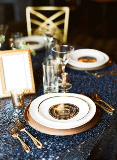 Navy, with gold chargers and white plates @Courtney Baker Baker Shaw: Fabulously Chic Weddings