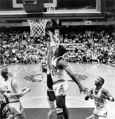 Black and white photo of University of Oregon basketball player Richard Lucas contesting an inside shot against Stanford during a game played at McArthur Court on February 1, 1990 and won by the Ducks 62-61. Also pictured are Oregon's Bob Fife (at left) and Terrell Brandon (#10). ©University of Oregon Libraries - Special Collections and University Archives Basketball History, Basketball Players, Terrell Brandon, University Of Oregon, February 1, Libraries, Ducks, Bob, Collections