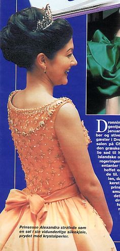 Jorgen Bender made in 1997 two ball dresses for Alexandra. They were going to be used for the Queens 25 year celebration as Queen . She wore the orange dress on January 13 , 1997 at  Christiansborg Castle and the Purple dress on January 16 , 1997. At the Royal Theater in Copenhagen.