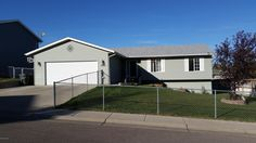 1404 BEAVER DRIVE $258,000 Beautiful ranch style home located near an elementary and junior high school. Completely finished and features 5 bedrooms, 3 bathrooms, 2 living spaces and a fenced in landscaped yard. New stainless steel appliances in kitchen and hard wood flooring through most of main level. Priced to sell at $260,000. For a private showing of this home contact Jason Thomas at 307-660-2340 or Sherry Thomas at 307-696-9924 for more information.