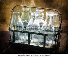 Google Image Result for http://image.shutterstock.com/display_pic_with_logo/576247/102536852/stock-photo-antique-glass-milk-bottles-102536852.jpg