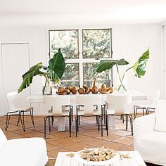 A simple arrangement of greenery becomes sculptural when set against bright white interiors. | Coastalliving.com
