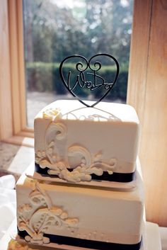 Absolutely love the cake topper! #wedo Photo by Ashely Y. #WeddingCakesMinneapolis