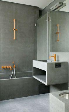 design salle de bains moderne en béton aux éléments oranges
