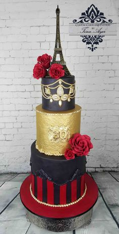 Moulin Rogue themed cake. Paris, parisian party. Red, black and gold themed. Stripes, jewels and eiffel tower on top with red roses. Designed and Handmade by Custom Cakes and Pastries by Tina Ayer Made in Melbourne Australia www.customcakesan... Facebook: www.facebook.com/... instagram: www.instagram.com...