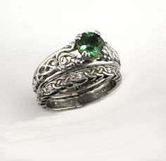 A stunning custom Wedding set in White gold, with hand carved swans on the ring with Celtic knot details, set with a stunning green sapphire. Irish Wedding Rings, Titanium Wedding Rings, Custom Wedding Rings, Celtic Engagement Rings, Perfect Engagement Ring, Vintage Engagement Rings, Vintage Rings, Celtic Spiral, Celtic Knots