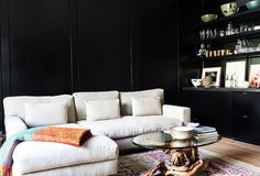 Black & white den with shelves / bar separating the room (fashion designer Jenni Kayne's home)