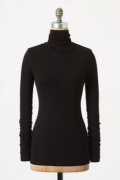 I must have at least 5 black, long sleeve turtlenecks in my closet!  That is a staple in my wardrobe when it gets cold outside!!!