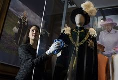 """The Queen' Robes of the Order of the Thistle on display at the Palace of Holyroodhouse in Edinburgh as part of the exhibition """"Fashioning a Reign: 90 Years of Style from The Queen's Wardrobe"""""""