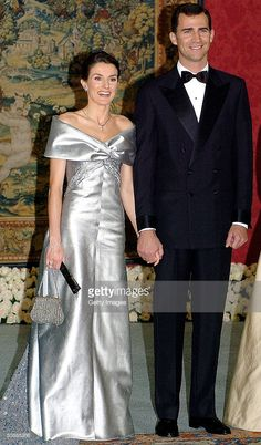 Spanish Crown Prince Felipe and his fiancee Letizia Ortiz Rocasolano pose for a picture as they attend a gala dinner at El Pardo Royal Palace May 21, 2004 in Madrid. Spanish Crown Prince Felipe de Bourbon and his fiancee, former journalist Letizia Ortiz are to wed in Madrid on Saturday, in the first royal marriage in Spain of a crown prince or a king in nearly a century.