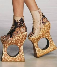 Good luck trying to walk with a pair of these. Created by Guo Pei - a chinese haute couture designer dubbed 'Alexander Mcqueen of China' (Thanks, Joanne).