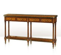 A burl lattice parquetry, brass mounted console table, four frieze drawers, on turned and fluted legs joined by an undertier. The original Louis XVI.