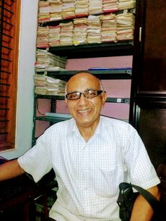 Advocate Jayaprakash Mallay at his office in Manjeri amidst dossier and file