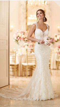 This romantic lace over matte-side Lustre satin wedding gown from Stella York meets all the desires of a modern bride. From its hand-sewn clear beading, sweetheart neckline with deep V detailing, cap sleeves, and keyhole back; to its easy-close back zipper and layered train. Color: ivory lace