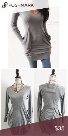 "Shae Grey Cashmere Blend Sweater ✦this soft grey sweater is made up of a stretchy fitted v-neck tee with with knit arms & a knit panel down the chest. On the sides are stylish & dramatic pockets✦{I am not a professional photographer, actual color of item may vary ➾slightly from pics}  ❥chest:16"" ❥waist:15"" ❥length:37"" ❥sleeves:26""shoulder-hem ➳cotton+cashmere+Koplon+wool/hand wash  ➳fit:tunic/true ➳condition:pre-loved, no rips/stain  ✦20% off bundles of 3/more items ✦No Trades  ✦NO HOLDS ✦No…"