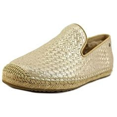 b0e3f7091d7 UGG Women s Sandrinne Metallic Basket Soft Gold Leather Flat 9 B (M).  Sheepskin heel lining. Leather insole Lining. Jute and Rubber Outsole.