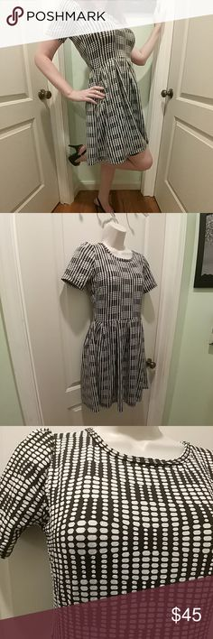 💃 Lularoe B&W Amelia, XS Lularoe Black and White Amelia Dress Has pockets, zippered back Worn only long enough to take this picture (Love the dress, but it washes me out)  30% off a bundle of three or more items Everything is negotiable Smoke free home Pet free home All items deserve a 2nd chance at happiness Currently not trading LuLaRoe Dresses Midi