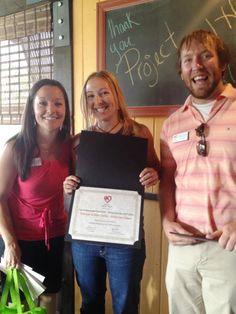 We love our Dining Out for Life® volunteers! Rebecca Jessie of the Denver Roller Dolls accepts one of three Top Dining Out for Life® Ambassador Recruitment Awards from Events Manager, Jessica Shoemaker, and Volunteer Resources Coordinator, Keegan Kuhlmann.