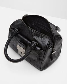 752862d5dcdb Luggage Lock mini cross body bag by Ted Baker