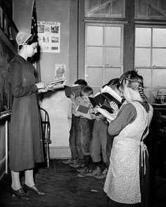 +~+~ Vintage Photograph ~+~+  Mennonite school teacher with her Amish, Mennonite and Pennsylvania Dutch students.  Lancaster County, 1942.