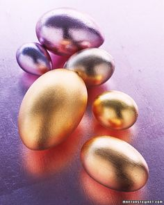 Apply gold and silver leaf over blown eggs for an elegant touch. We decorated chukar and turkey eggs in lavender and champagne-pink silver leaf, and chicken, pullet, turkey, and goose eggs in varying shades of gold leaf.     Gold leaves and gilding glue are available at Pearl Paint.