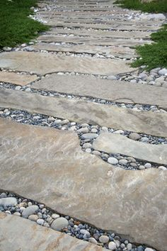 Creating permeability with larger rocks (not sand or tiny pebbles to get caught in shoes) - is this practical for patio, paths or driveway?