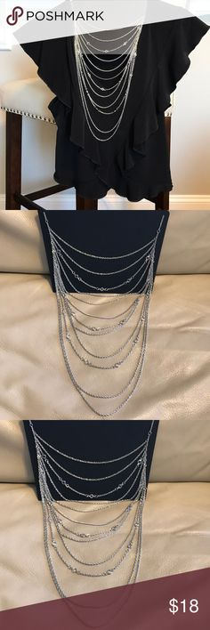 """Sexy Multilayered Silver Chain Necklace Beautiful multilayered silver necklace! This necklace is so cute and so light to wear you will want to put it on with everything  20"""" diameter with adjustable chain 14"""" without adjusting  11"""" inches the layers hang Jewelry Necklaces"""