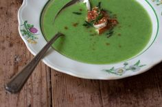 Green Pea Soup Recipe  3 tablespoons fresh ginger, well chopped  10 sm-med cloves garlic, smashed and peeled  2 serrano chiles, stemmed and chopped  1/4 teaspoon ground cumin, plus more to serve  3 tablespoons ghee or sunflower oil (for veagan)  2 bay leaves  1 medium onion, chopped  4 1/2 cups good-tasting vegetable stock or water  3 1/2 cups / 500 g / 18 oz shelled fresh or frozen peas  1 teaspoon sea salt, or to taste  a squeeze of fresh lemon juice  8 fresh mint leaves, slivered